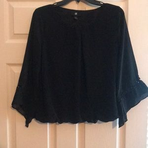 Black Blouse with cut out sleeves at the bottom